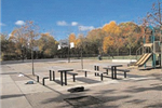 Picnic tables next to a playground structure